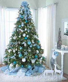 But if you truly want to stand out, we'd suggest you go for a blue Christmas tree this year. we've gathered a list of blue Christmas tree decoration ideas. Blue Christmas, Turquoise Christmas, Silver Christmas Decorations, Modern Christmas, Coastal Christmas, Elegant Christmas, Christmas 2015, Merry Christmas, Teal Decorations