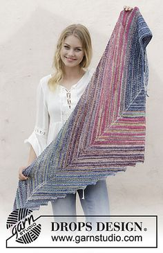 Knitted shawl with garter stitch and stripes. The piece is worked in DROPS Fabel.