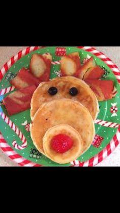 Pankakes, bacon, blueberries(?), and strawberry.... YUMMMM!!!