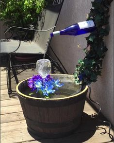 Wine bottle and glass fountain. Wine bottle and glass fountain. Wine Bottle Fountain, Diy Water Fountain, Diy Garden Fountains, Fountain Ideas, Water Fountains, Fountain House, Outdoor Fountains, Garden Ponds, Koi Ponds
