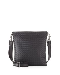 9a6b0d7d0966 Men s messenger bag in Bottega Veneta signature intrecciato woven leather.  Gunmetal colored hardware. Zip
