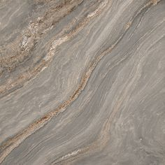 Elegant Italian marble with swirling blue tones rarely found in nature. The cross cut veining creates billowing clouds of color and features tiny metallic flecks on the surface.