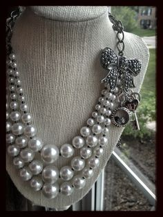 Origami owl conference necklace for Gala. Pearls with a silver crystal mini locket, key and lock dangles.  Book a party or Join our team...it is so amazing!!