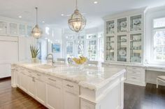 Excellent, huge, white + marble kitchen. So much to love. Built-in desk. The counters. The cabinetry + built-in china cabinet.