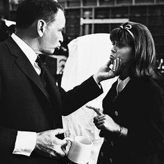 Frank holds daughter Nancy's face on the set of Marriage On The Rocks, c. 1965.