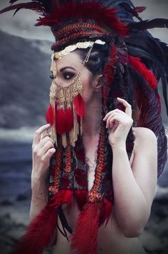 interesting headdress, brilliant colors. love the chains