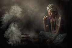 Woman in traditional costumes at Karen drink coffee in Chiang Mai, Thailand. | Thampitakkull Jakkree