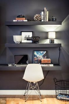 modern grey study space with a shelf used as a desk
