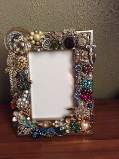 Frame I made from vintage earrings & vintage broaches....