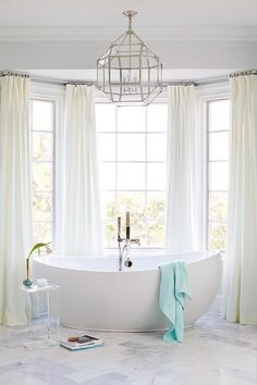 Custom Master Bathroom Design with Freestanding Tub Bath Architectural Detail Design Detail Architectural Details TraditionalNeoclassical Transitional by Kara Cox Interiors Bathroom Window Curtains, Bathroom Window Treatments, Bathroom Windows, Bay Window Dressing, Amazing Bathrooms, White Bathrooms, Small Bathroom, Master Bathroom Tub, Bathroom Tubs