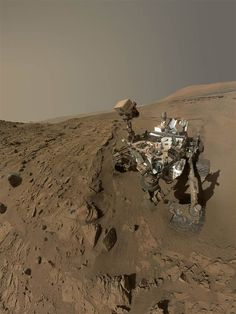 """NASA's Mars Curiosity rover used the camera at the end of its arm in April and May to take dozens of component images combined into this self-portrait where the rover drilled into a sandstone target called """"Windjana."""" The selfie was released on June 23, a day before the """"Marsiversary"""" of the robot's landing on Mars. By Earth's reckoning, that landing happened almost two years ago — 687 days, which equals one Martian year."""