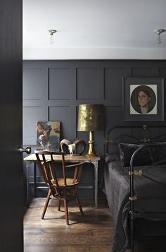 Dark bedroom wall, navy walls, charcoal gray walls, board and batten, paneled walls, gold accent, metallic accent, reflective accent