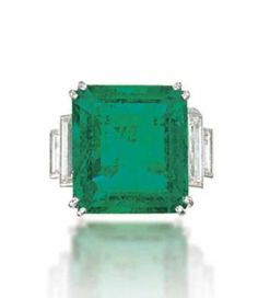 Lot 191 -  AN EMERALD AND DIAMOND RING, MOUNTED BY CARTIER