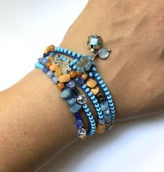Blue and gold beaded wrap bracelet or necklace, crochet, bohemian jewelry, crochet jewelry, bead crochet, boho bracelet, coffycrochet by CoffyCrochet on Etsy https://www.etsy.com/listing/537108255/blue-and-gold-beaded-wrap-bracelet-or