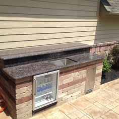 Be the coolest neighbor on the block with a built-in outdoor mini-fridge, counter and sink, perfect for entertaining!