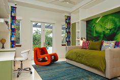 Designer: Cudmore Builders, Boca Raton, FL The combination of the Star Wars themed wall mural, modern furniture, and soft furnishings make this a brilliant kid's room. The colors in the room coordinate well with the Yoda wall mural without being distracting.