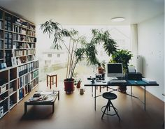love the window, the wall full of books and the plants.. It looks like a great place for an office =D