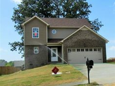 This Gorgeous Two Story Floor Plan Features Hardwood Floors ~Large Master Bedroom w/ Walk In Closet~Master Bathroom w Separate Shower and  Tub~Privacy Fence~Gorgeous Mature Oak Tree in Back Yard   Call Me Today  931-278-2437