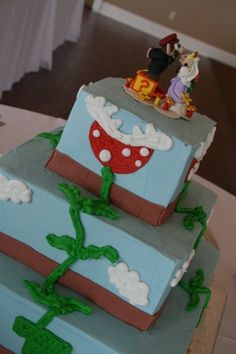Custom Mario and Peach wedding cake. The topper is from etsy made to the colors of my wedding and the cake is by  http://www.ruthiescakes.net