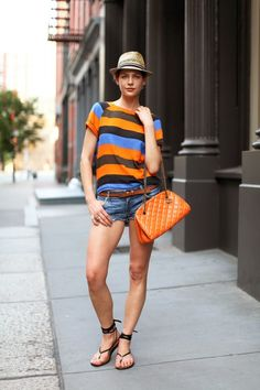 orange and blue with chocolate striped, a fedora and a pixie cut = perfect