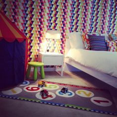 Children's bedroom featuring Harlequin fabric and wallpaper - #designedbyjustso #childrensbedroom