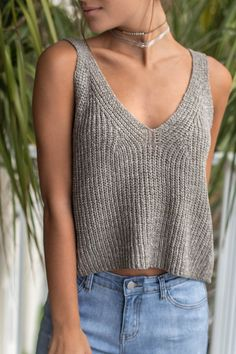 - Light olive sweater crop top is sleeveless and features crochet details with no lining - Material is Cotton and Acrylic - Model Addison is 5'7 wearing a small Bust Length Small 18 18 Medium 19 19 La