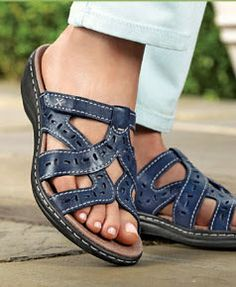 The Bendables technology means flexible comfort in Clarks Bendables Women's Leisa Truffle Slide Sandals. The lightweight, flexible EVA outsole and shock-absorbing OrthoLite® foam footbed make it easier to spend more time on your feet. #Sandals #FootSmart