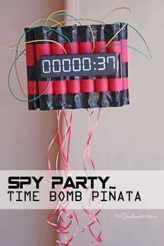 The perfect way to end a Spy Birthday Party! Kids have to disarm the time bomb piñata by pulling on the strings. {OneCreativeMommy.com} Such a cool pinata!