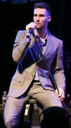 Adam Levine pf Maroon 5 sporting a sleek, handsome suit and clean cut look at House of Blues!