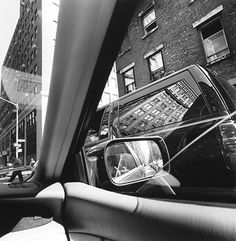 Credit: Lee Friedlander, courtesy Frankel Gallery, San Francisco New York City, 2002  Sometimes the lines, angles and reflections can be perplexing, in this case reflecting the chaos of the city