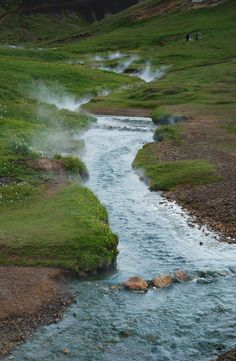 "Reykjadalur - The Smoky Valley This is a boiling hot river in a valley just outside Reyjavík. The valley is called Reykjadalur which simply means ""Smokey Valley"" for obvious reasons. The river seen here is nearly boiling and far too hot to bathe in, however, just to the right of the photo a cold river mixes with the hot river. Below that it is perfect to bathe. It is quite easy to get here. This is the precise location on an aerial photo. To get there you simply park your car on ..."