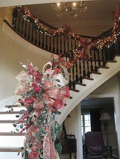 Kristen's Creations: Mantles, Trees and Staircases... This bow is a beautiful focal point for the staircase garland!