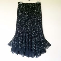 Chico's mermaid skirt Beautiful black two layers of mermaid style skirt with white dots. size 1 but more like a 5 or 6. Still has the original tag on it. waist: 13.5'', can stretch to 21''. length: 34''. From pet free and smoke free home. Chico's Skirts Asymmetrical