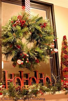 Christmas mantle by eli.na-Loke the wreath on mirror idea.