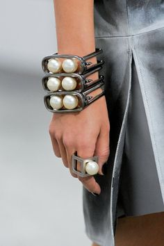 Chanel Spring 2014 fab minimalist contemporary bracelet and ring,pearl and silver geometric design goes well with goood tailored linen clothing pinafore or apron dresses simple suare line cut clothes in neutral tones