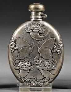 Selling  silver engraved perfume bottle.