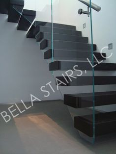 Floating Wood Staircase - Glass Railing - side elevation of decorative caps