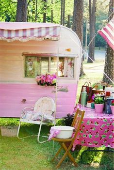 Pink caravan, striped awning, camping in the bush #sistersonthefly