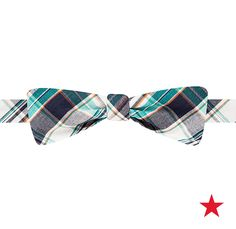 A preppy plaid bow tie adds a dash of distinction to his look, not to mention a few cool points, too! Countess Mara
