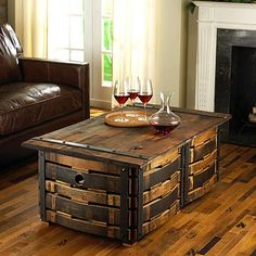 Very Cool Reclaimed Wine Barrel coffee table with wine bottle storage. Made form retired wine barrels and reclaimed wood top. Wine Barrel Coffee Table, Barrel Table, Wine Table, Coffee Table With Storage, Coffee Wine, Coffee Tables, Wine Barrel Crafts, Barris, Wine Bottle Storage