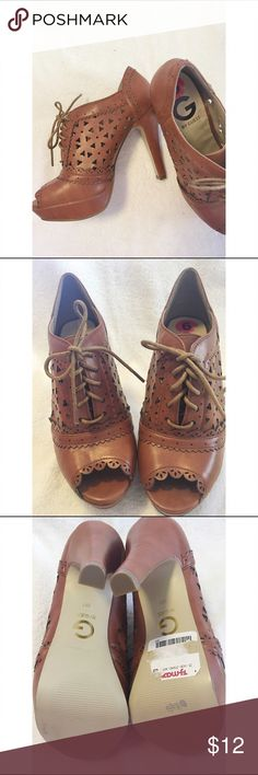 """G by Guess Shoes This pair of G by Guess Shoes are NEW with torn tag as shown in picture. Never worn they are brown and lace up  the heel is approx. 4.5"""". G by Guess Shoes Heels"""