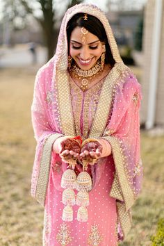 4a Indian bride portrait in pink suit salwar kameez with gold jewelry.  More here - http://www.indianweddingsite.com/beautiful-illinois-fusion-sikh-wedding-almond-leaf-studios/