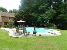 Dive right in! Relax in your own back yard pool. 437 Drayton Park Dr, Kernersville, NC 27284