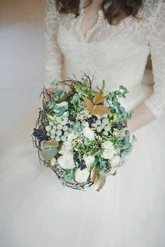 winter bouquet + lace gown, photo by katie Purnell http://ruffledblog.com/intimate-irish-wedding #bouquet #flowers #lace