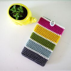 Stash Buster Tablet Case Pattern Make a cute case for your tablet while using up that leftover yarn - a great stash buster crochet project! Crochet Phone Cover, Crochet Case, Love Crochet, Crochet Gifts, Diy Crochet, Crochet Stitches, Crochet Patterns, Crochet Ideas, Yarn Projects