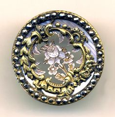 brass, pearl and steels button