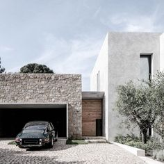 Minimalist House with Stone Wall Accents #architecture