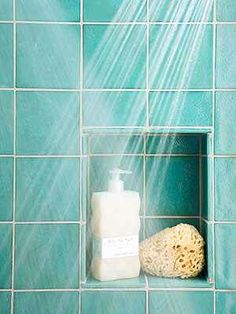 Rather than add a space-gobbling storage tower or corner shelf to your small shower, transform the cavity between studs into a storage niche. Line the niche with waterproof materials that complement or match shower walls, such as ceramic tiles or solid-surfacing, or use a molded prefab shower niche to add recessed storage.