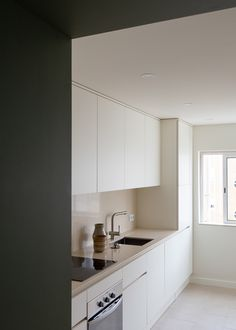 Carnide Apartment is a minimalist apartment located in Lisbon, Portugal, designed by Lola Cwikowski Apartment Kitchen, Kitchen Interior, Kitchen Design, Kitchen Decor, Kitchen Living, Living Room, Modern Grey Kitchen, Minimal Kitchen, Mudroom Cabinets