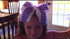 How to Make A Big No Sew Cheer Bow, via YouTube. A different technique than I use...zip tie instead of flower wire